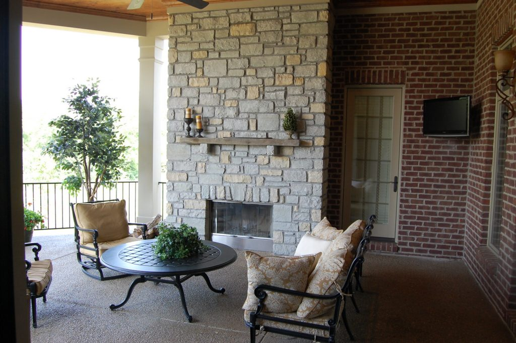 Exterior Gallery - Covered patio with fireplace - J&K Custom Homes