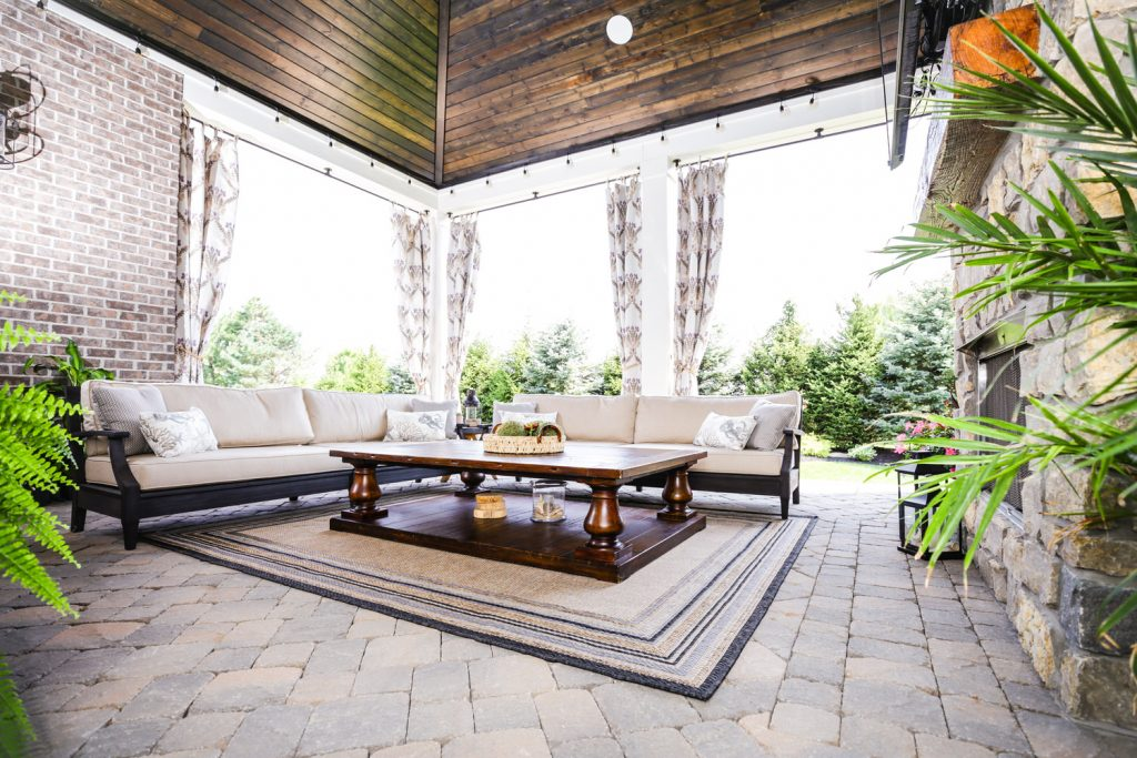 Custom Outdoor Living Space with pavers and fireplace - J&K Custom Homes