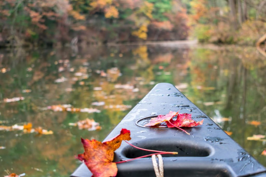 Meadowbrook Estates - Canoe with colorful autumn leaves - J&K Custom Homes